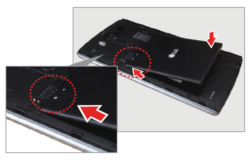 Inserting the battery into the rear of the smartphone